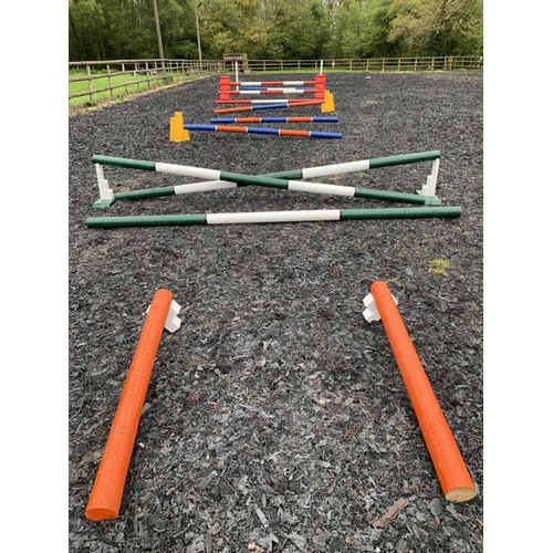 Green, orange, blue and white and red HCF used on horse jumps